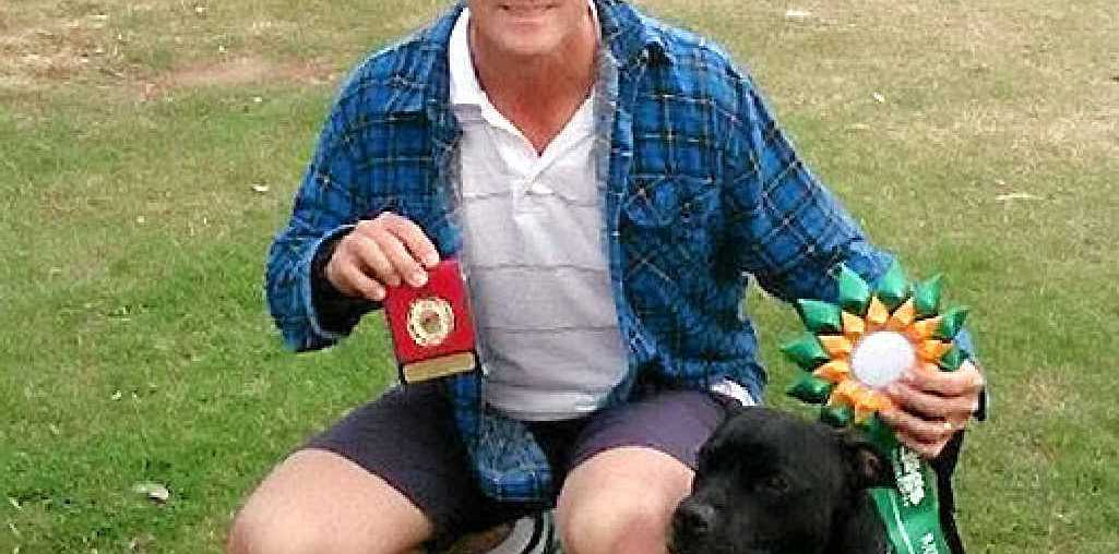 GOT THERE: Frank Braes with his dog Billy after winning an Australian title in the novice class.