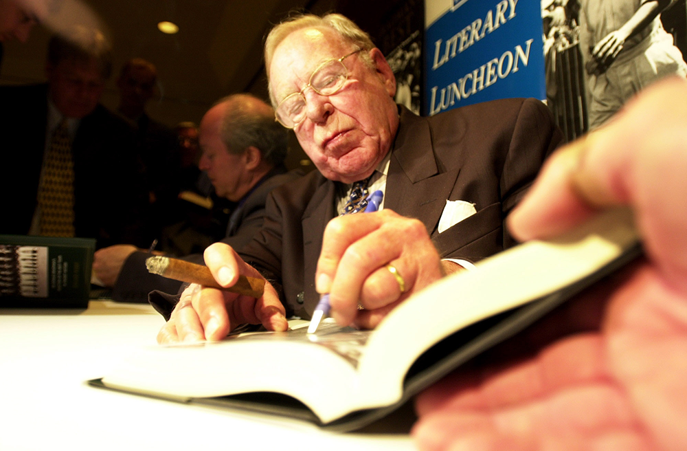 Sydney, August 13, 2001. Author Roland Perry (left) and former invincible Arthur Morris sign copies of the Roland Perry book Bradmans Best.