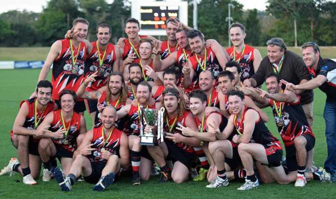 Satell/Toormina celebrates winning the 2015 AFL North Coast grand final.