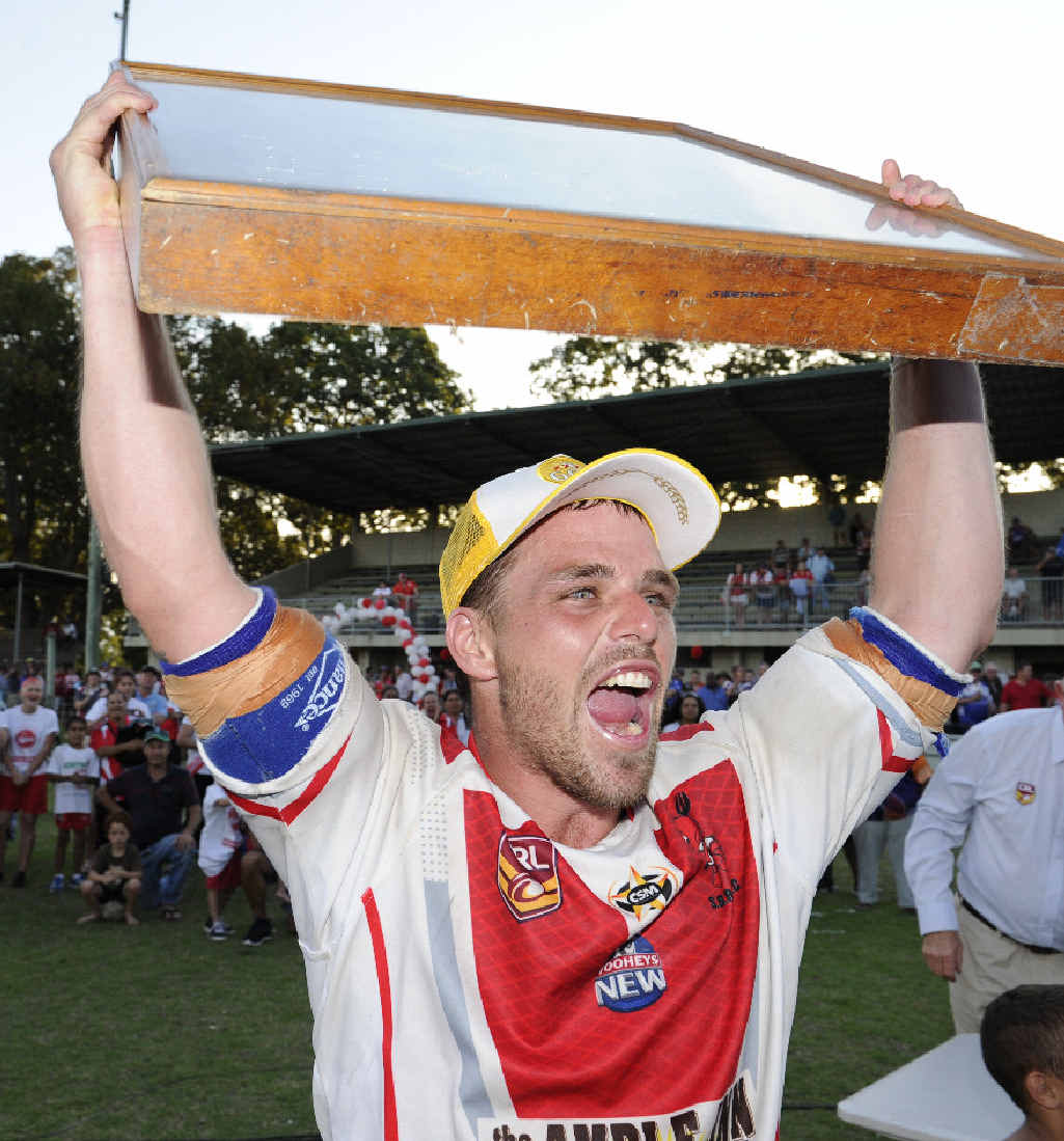 VICTORIOUS: South Grafton Rebels captain Rhys Walters holds the Group 2 first grade premiership aloft.