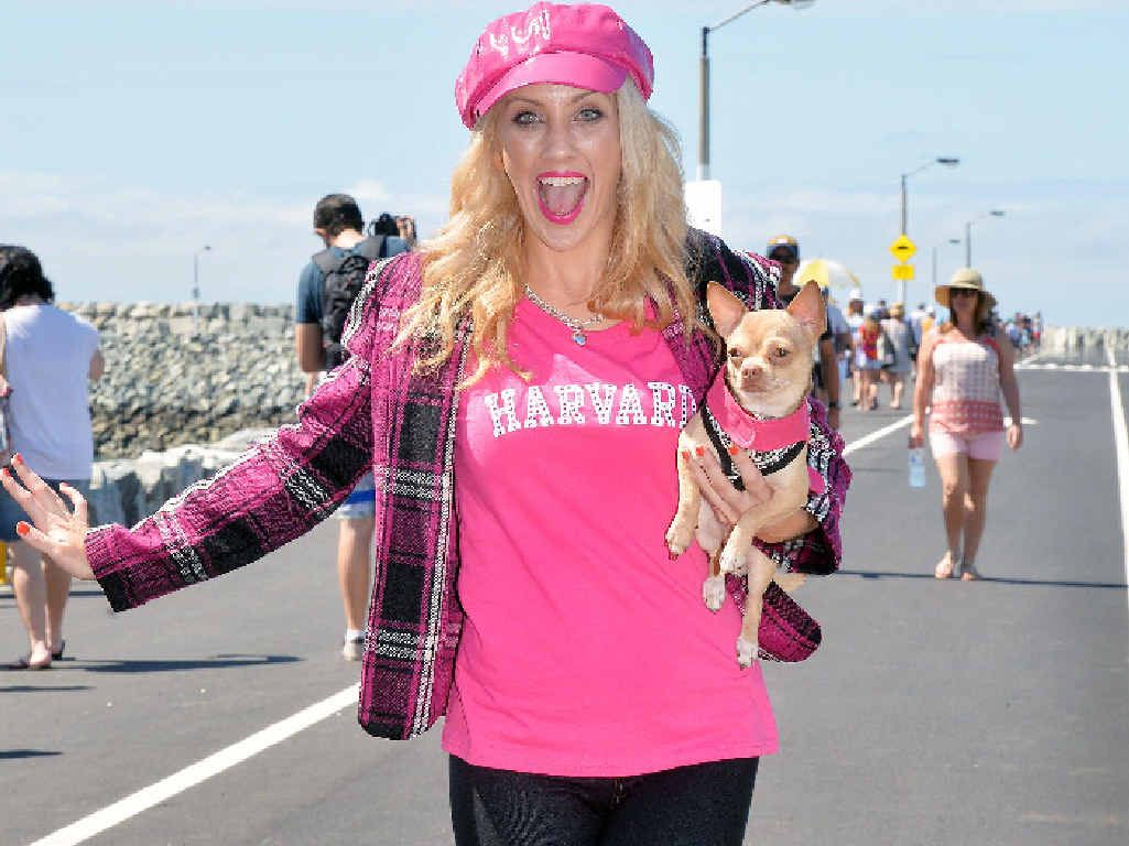 Sam Robertson, who plays Elle Woods in the upcoming Mackay Musical Comedy Players production 'Legally Blonde' and Taco her dog. The pair was at the opening of the Mackay Marina breakwater promoting the musical, held at the MECC on September 11 and 12.