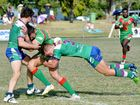 HARD FOUGHT: Sarina's Dean Hall tackled by Brahmans players David Kay and Alex Clare.