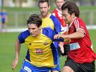 MISERY: The Fire's Kenya Takahashi chases down his Brisbane Strikers opponent.