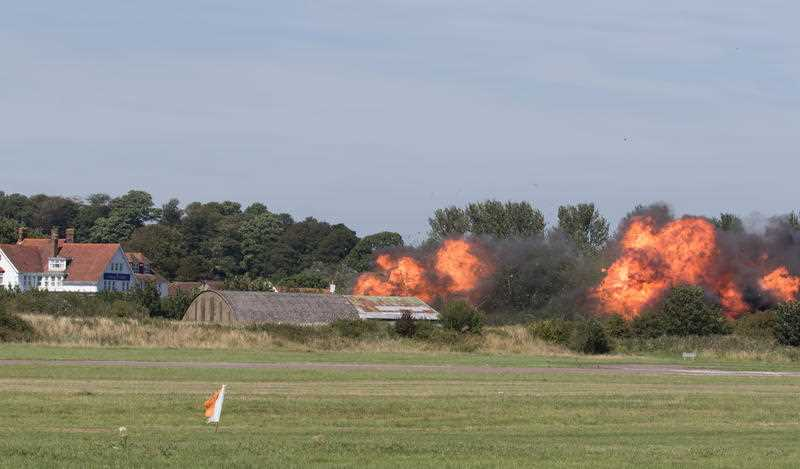 UK, Shoreham-by-Sea: Flames erupt from the site of a fatal accident, wherein a Hawker Hunter jet crashed into several vehicles and exploded, leaving at least seven dead at the Shoreham Airshow in Shoreham-by-Sea, UK on August 22, 2015.