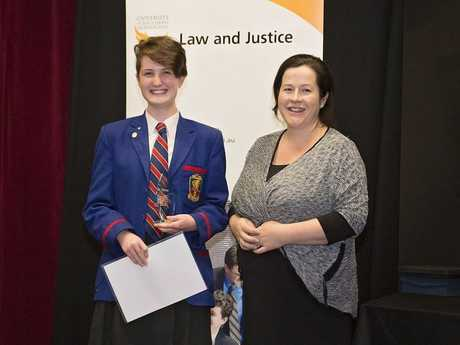 Best Advocate award recipient Downlands student Clancy Tully receiving the Best Wilson Buckley Prize from Ms Kara Best of Best Wilson Buckley Family Lawyers.