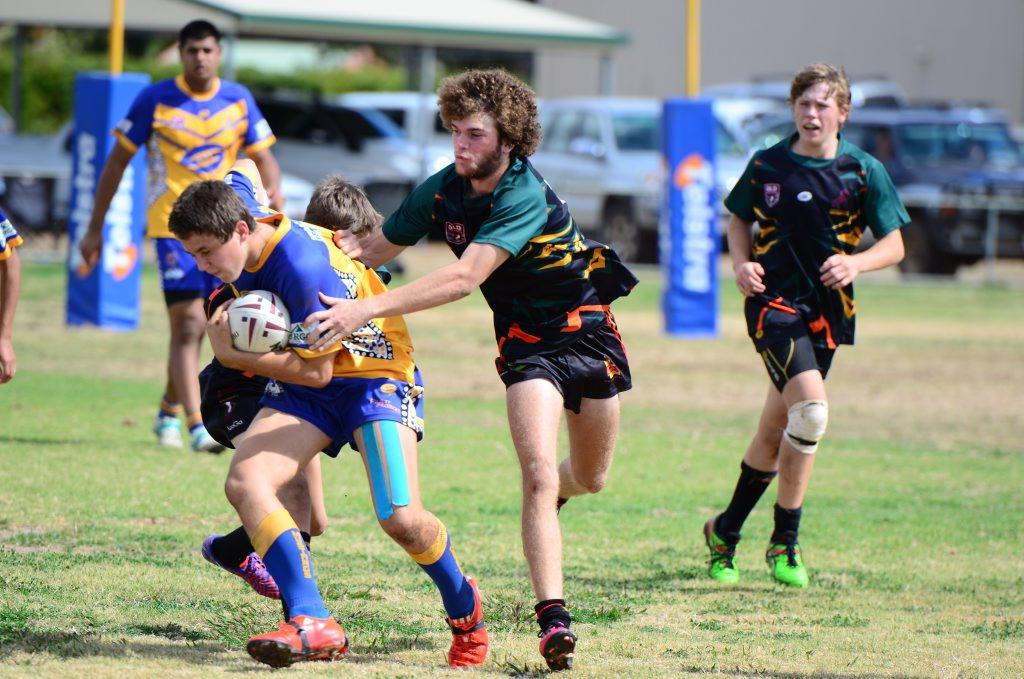 Byron Yesberg gets tackled by Dawson Cross. Photo Keagan Elder / South Burnett Times