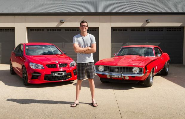 V8 Supercars driver Garth Tander at home with his HSV GTS and 1969 Chevy Camaro. Photo: Contributed