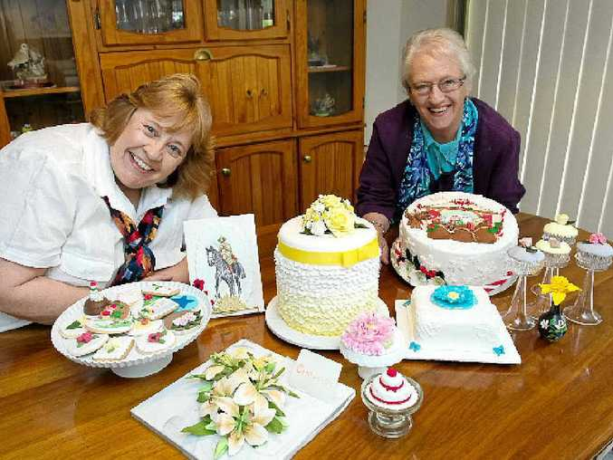 WORKS OF ART: Coffs Coast cake decorators Carol Williams and Elaine McInnes with some of their creations.