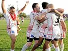 CHEER: Rebel Oral Monaghan (left) joins his teammates in celebrating a try during South Grafton's 46-18 win.