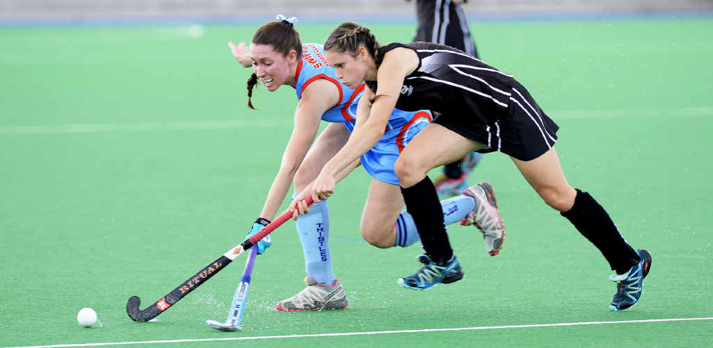 WITHIN REACH: Wests speedster Jade Emblem battles with Swifts/Thistles defender Erin Alchin in Saturday's A-grade match. Wests won 4-0.
