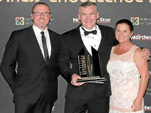 BUSINESS OF THE YEAR: General manager of the Ballina Shire Advocate Paul Spotswood (left) presents Ballina Campervan and Motorhome Centre/Horizon Motorhomes owner Clayton Kearney and his wife Kylie with the award.
