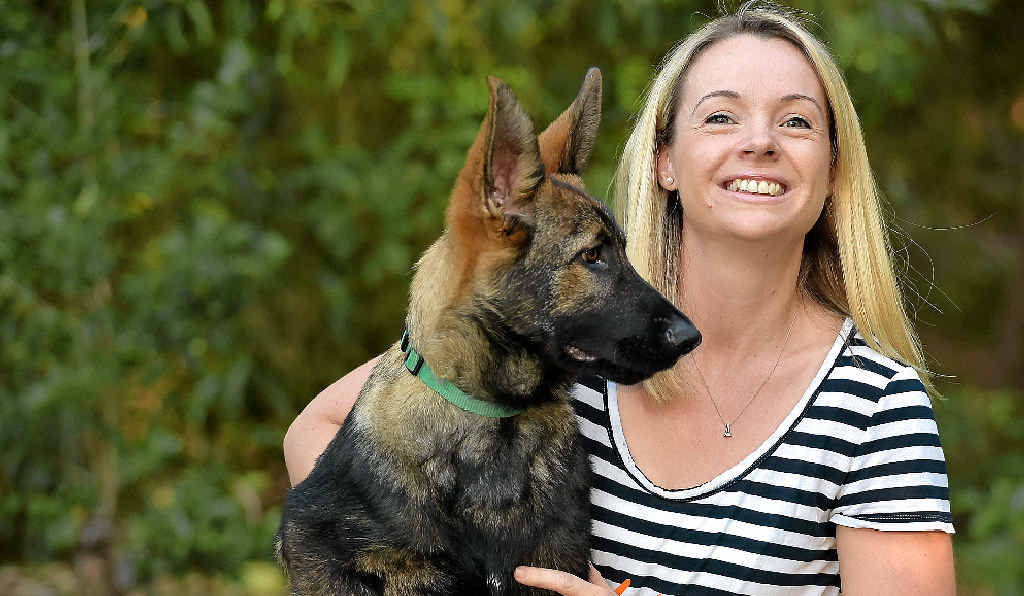 IN SAFE HANDS: Jennifer Rowan with one of the dogs they rescued from a Yandina property. INSET: One of the dogs before it was rescued.