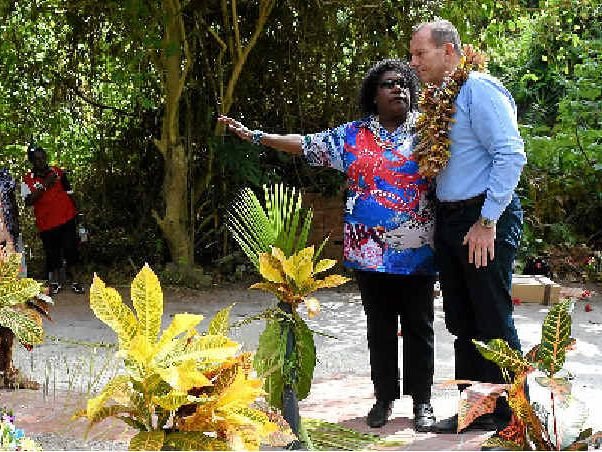 REMEMBERING THE FIGHT: Prime Minister Tony Abbott and Gail Mabo laid a wreath on Eddie Mabo's grave on Mer Island in the Torres Strait.