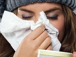 10,000 more hit by flu in Qld, NSW as mum-of-two dies in ACT
