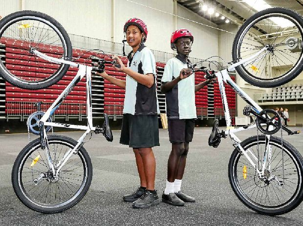 SWEET RIDE: Bundamba State High School students Kome Ropati and Mait Arop participate in the Happiness Cycle program.