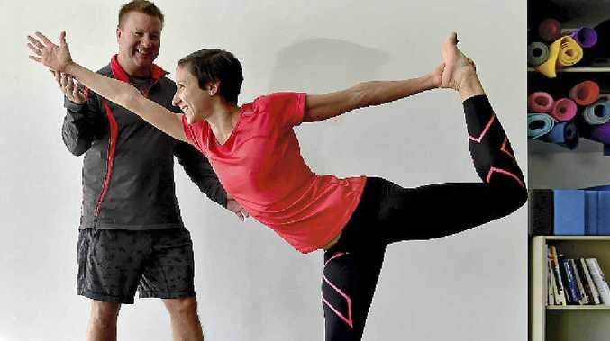 WINNER: Marathon runner, Australia Zoo vet and yogi Melanie Panayiotou and teacher Bryan Castle, of Yoga Vida, say yoga is part of a healthy lifestyle.