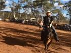 Bull charges at pair filming rodeo