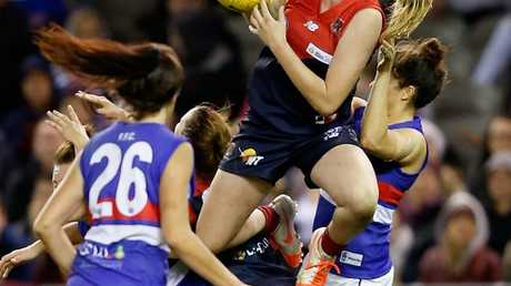 MELBOURNE, AUSTRALIA - JUNE 29: Tayla Harris of Melbourne takes a high mark during the women's exhibition AFL match between the Western Bulldogs and the Melbourne Demons at Etihad Stadium on June 29, 2014 in Melbourne, Australia. (Photo by Darrian Traynor/Getty Images)