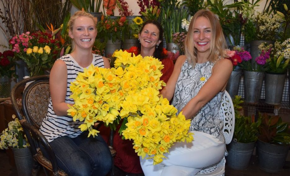 DAFFODIL DAY: Rowena Terone from the NSW Cancer Council with the owner of Passion@flowers, Jan Goodwin and Sarah Royall coordinator of Daffodil Day