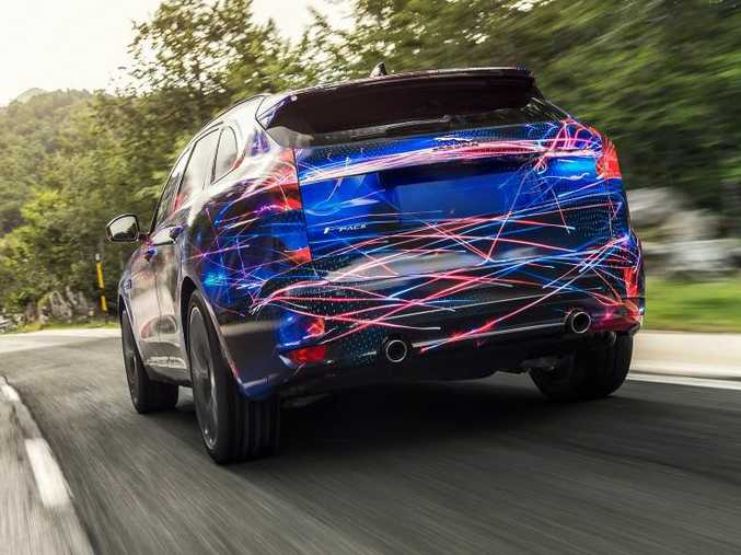 IN DISGUISE: F-Pace still not revealed fully, but Jaguar happy to tease us with colour for now