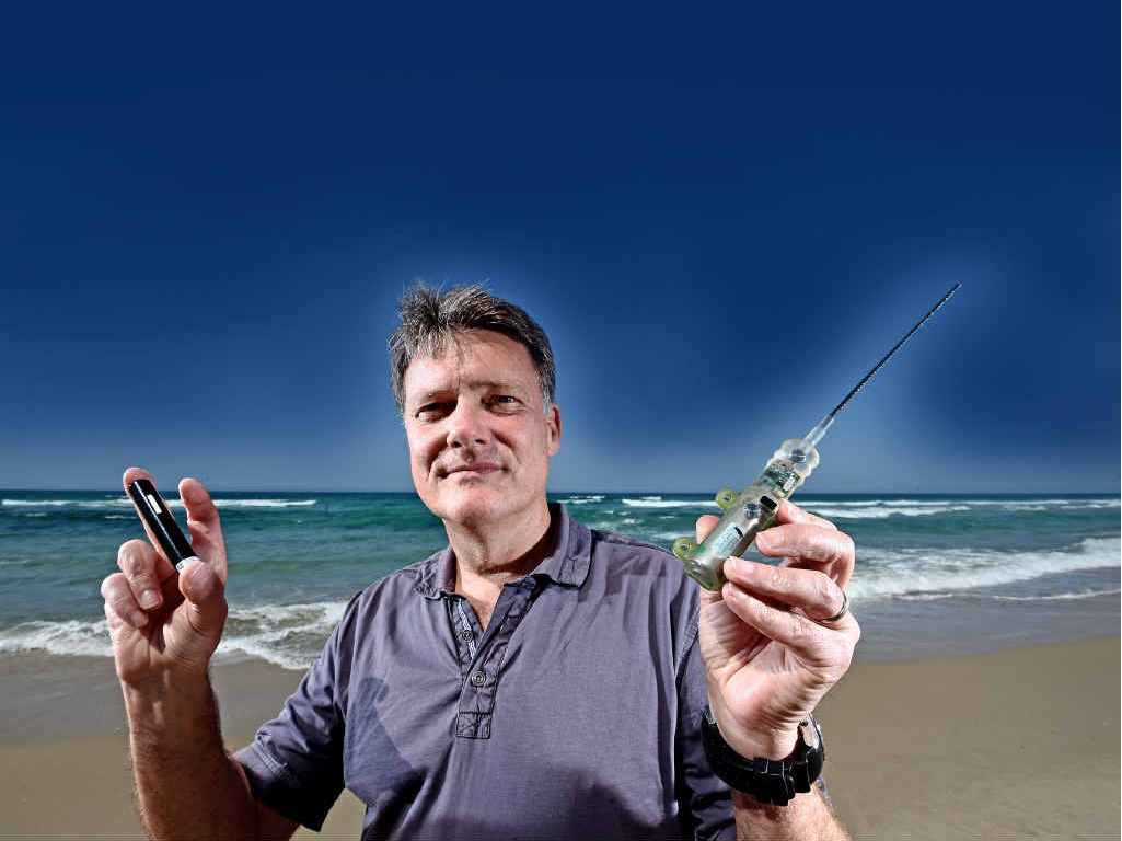 SHARK TALK: Dr Vic Peddemors from the Department of Primary Industries with some of the gear that will be used in the upcoming shark tagging program.