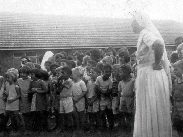 NEERKOL INJUSTICES: A Sisters of Mercy nun watches over the children at Neerkol Orphanage. Yesterday, a submissions report by Sophie David SC was released to the public.