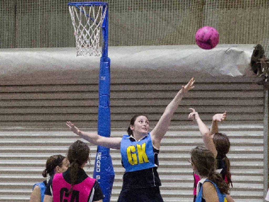 SLAMMIN' SHOWDOWN: A-grade player Susan Ellis, Doorslammers (GK), defending a shot in the A-grade major semi-final.