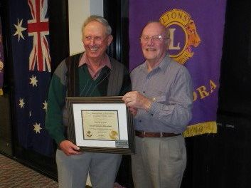 Don McLachlan accepts his life membership of the Lions Club from past president Ian (Scotty) Collinson.
