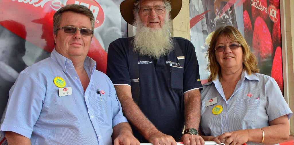 SUPPORTING THE LOCALS: Bruce, Lachie and Deb getting ready for IGA's Grocery Grab.