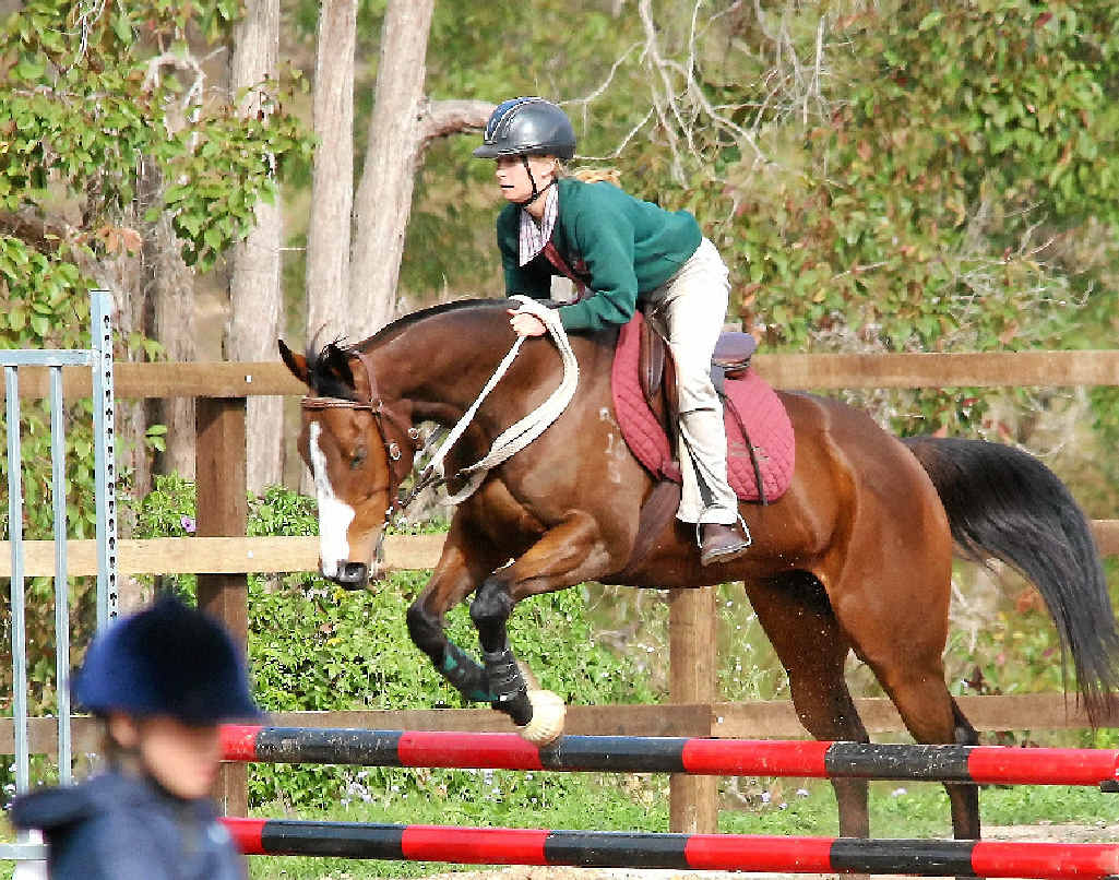 Erin Newman clears a jump in the showjumping.