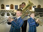TOP LESSON: Year 6 Grammar School students Oliver Schubert (left) and Sam Raccanello with Queensland Symphony Orchestra principal tuba Thomas Allely after a master class.