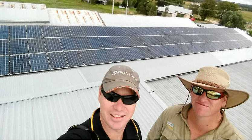 POWER SOLUTION: Tim Hourigan and electrician Alex Briers with the final product.