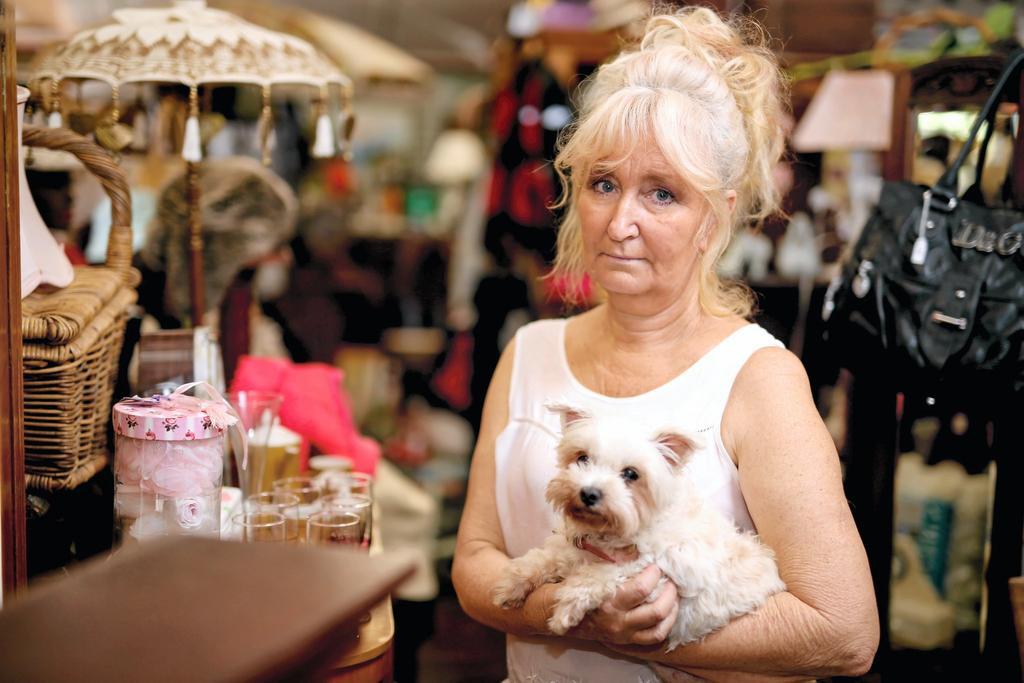 Julie Hitchens in her Uki antique store.