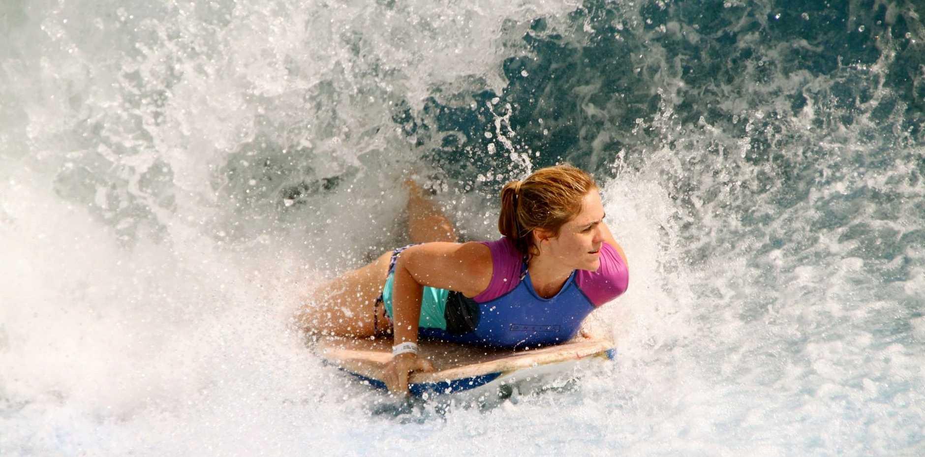 Rebecca Gallehawk takes on the flowboarding wave machine at Singapore's Sentosa Island.