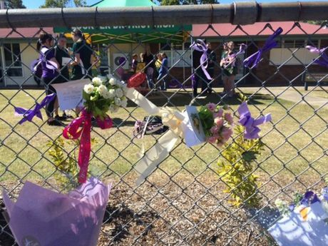 Floral tributes left outside Lockyer District High School.