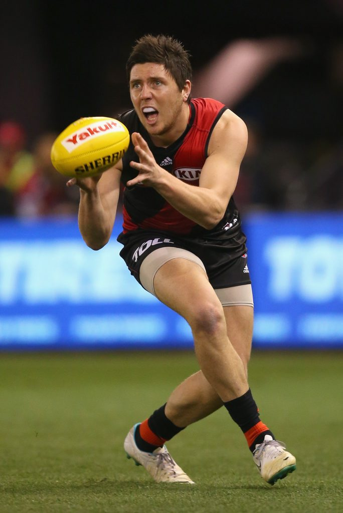 MELBOURNE, AUSTRALIA - JULY 25: Nick O'Brien of the Bombers marks during the round 17 AFL match between the Essendon Bombers and the Port Adelaide Power at Etihad Stadium on July 25, 2015 in Melbourne, Australia. (Photo by Quinn Rooney/Getty Images)