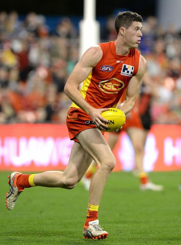 GOLD COAST, AUSTRALIA - AUGUST 22: Henry Schade of the Suns in action during the round 21 AFL match between the Gold Coast Suns and the Essendon Bombers at Metricon Stadium on August 22, 2015 in Gold Coast, Australia. (Photo by Bradley Kanaris/Getty Images)