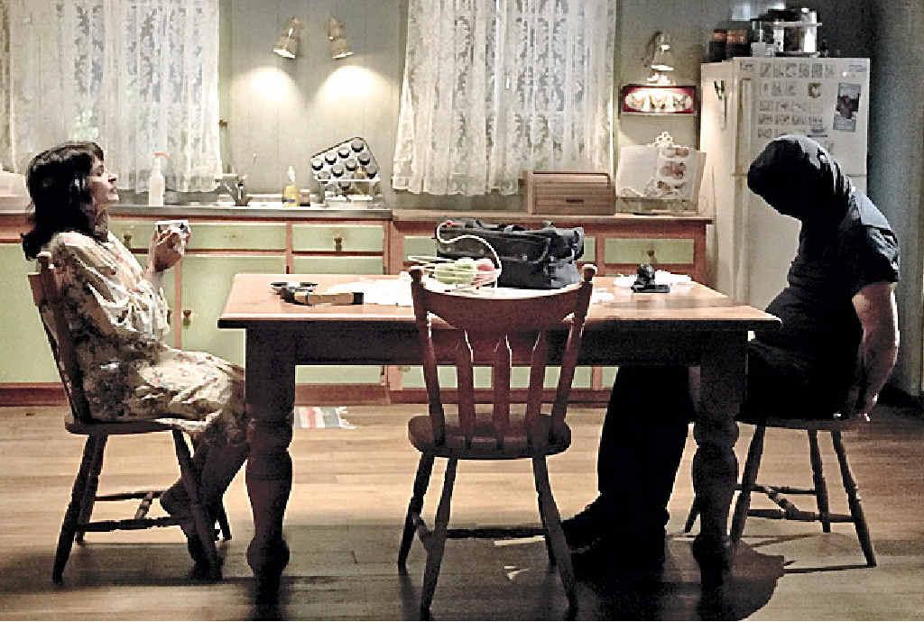 ROMANCE? : Kaarin Fairfax and John Jarrat in a scene of StalkHer.