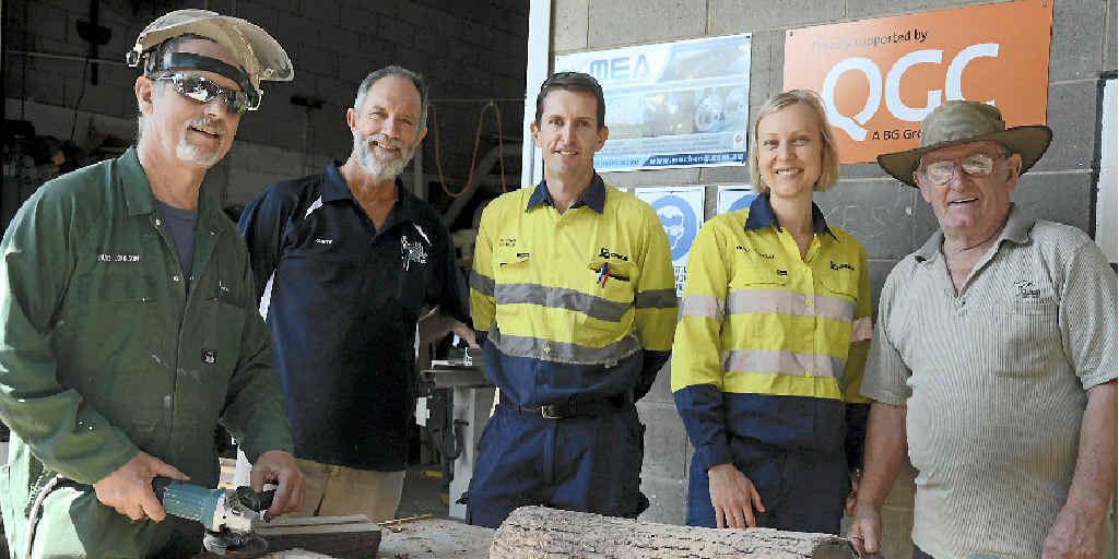 HELPING HANDS: Orica employees Matthew Adamson and Nicole Connolly with Gladstone Men's Shed members David Johnson, Gerry Graham and Mal Ford at the Off St premises.