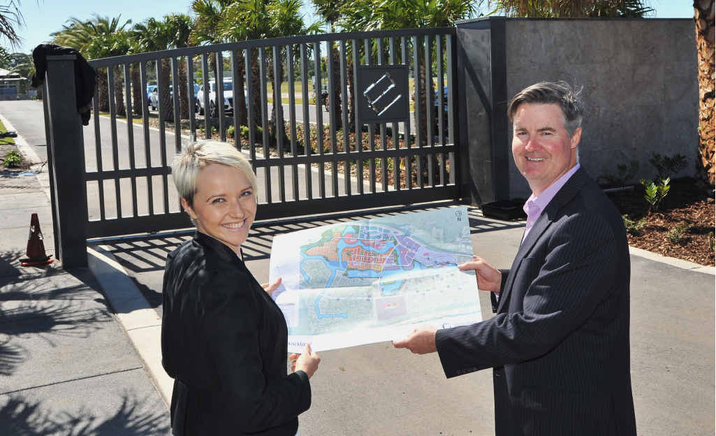 BIG PLANS: Amber Werchon from Amber Werchon Property and Andrew Stevens from KHA Development Managers check out plans for Entrance Island at Birtinya.