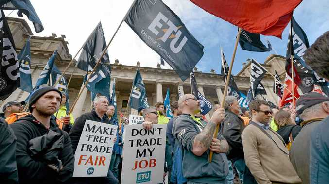 NOT FAIR ENOUGH: Union and community members rally yesterday on the steps of the Victorian Parliament in Melbourne to demand changes to the China-Australia Free Trade Agreement.