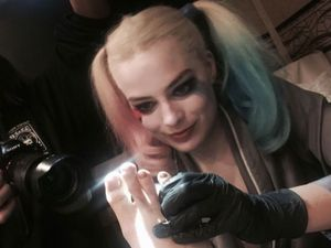 Cara Delevingne tattooed by Margot Robbie