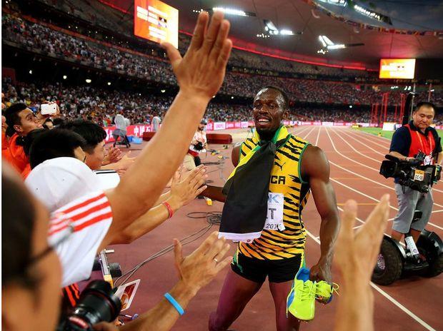 Usain Bolt celebrates as a cameraman follows him on a segway