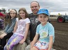 Enjoying the fun of the Scoot Mason Tractor Pull is Reuben Steinohrt with his kids (from left) Aaliyah, Sierra and Lincoln Steinohrt.