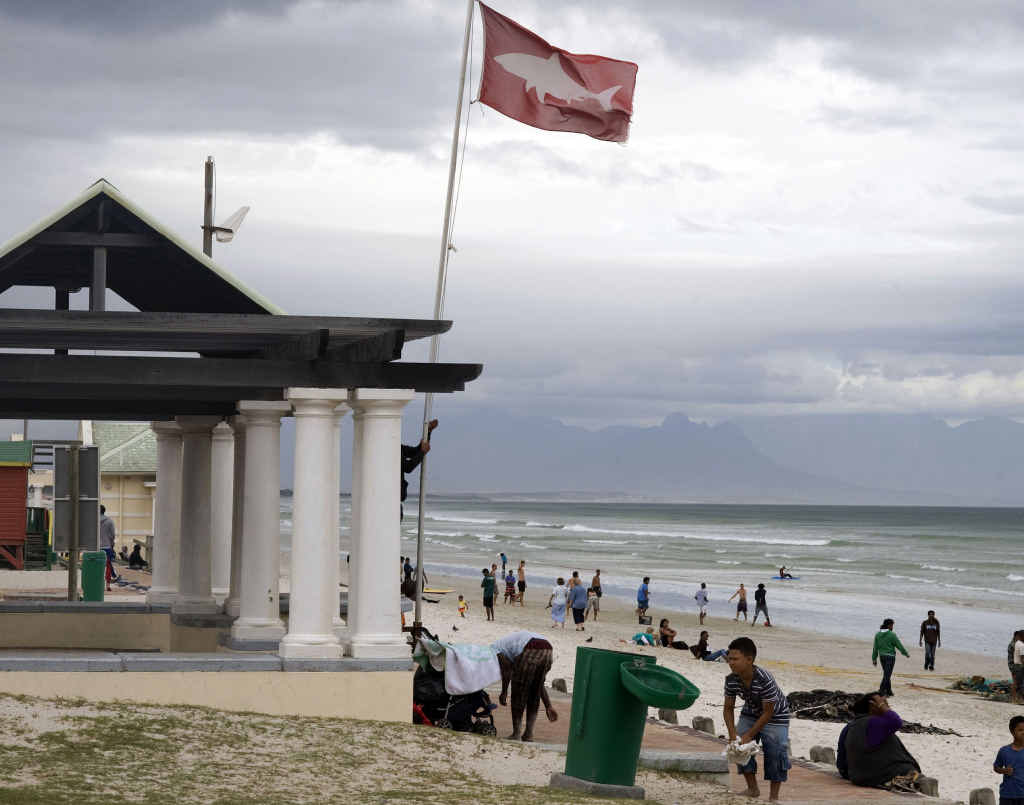 SOUTH AFRICA: A shark spotter raises the high shark alert flag on Muizenburg beach, near Cape Town.
