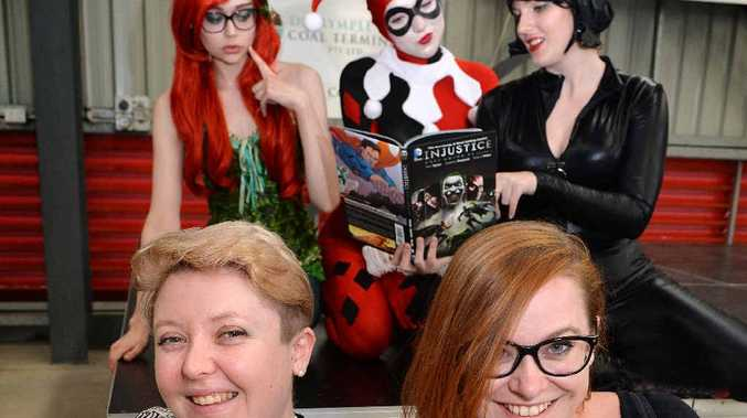 Alisha Jade (front left) and Becky Cloonan (front right) pose with Poison Ivy (back left), Harley Quinn (middle) and Cat Woman (back right) at Mackay's Sugar City Con.