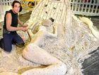 FINAL TOUCH: Dennis Massoud finishes his sand sculpture.