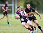 ON THE RUN: Charlie Mckill, of Noosa, tries to escape a tackle in yesterday's game.