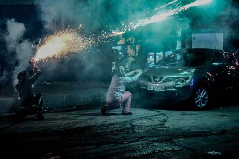 Masked kurdish millitants fire fireworks towards Turkish police during clashes during clashes on August 27,2015 in the Gazi district of Istanbul. Five people, including two children and a soldier, were killed in clashes between Kurdish militants and security forces in Turkey's restive Kurdish-majority southeast on August 27, 2015, local officials and the army said.