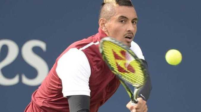 Nick Kyrgios, of Australia, returns to John Isner, of the United States, during the Rogers Cup men's tennis tournament in Montreal, Thursday, Aug. 13, 2015.
